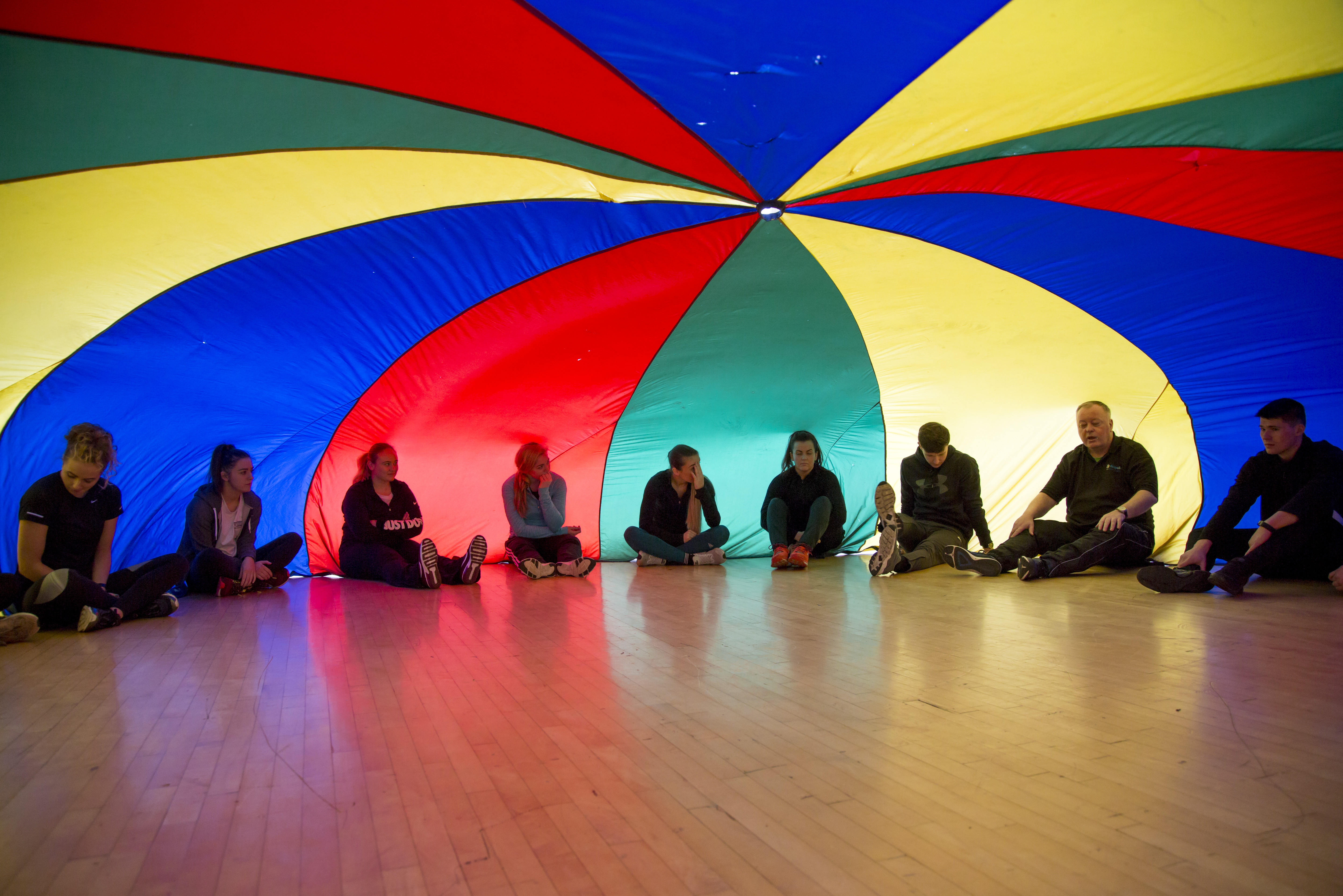 Image of people sitting under colourful dome
